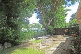 Backyard with gate that leads to Chattel Village