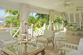 Covered verandah leads to garden and swimming pool terrace