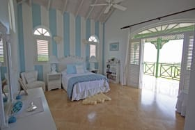 Upstairs guest bedroom with balcony