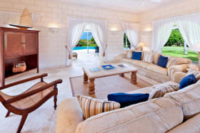 Living room opens to verandahs and garden