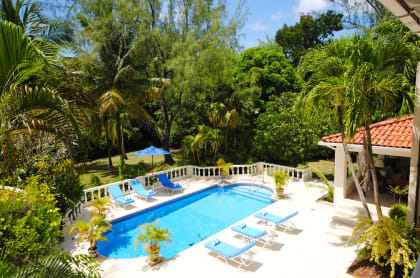 View of the swimming pool from the upstairs balcony