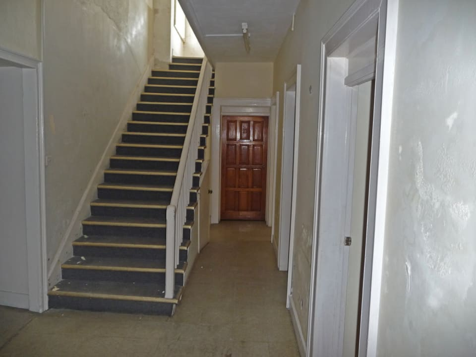STAIRS LEADING UP TO 1ST FLOOR IN MAIN BUILDING