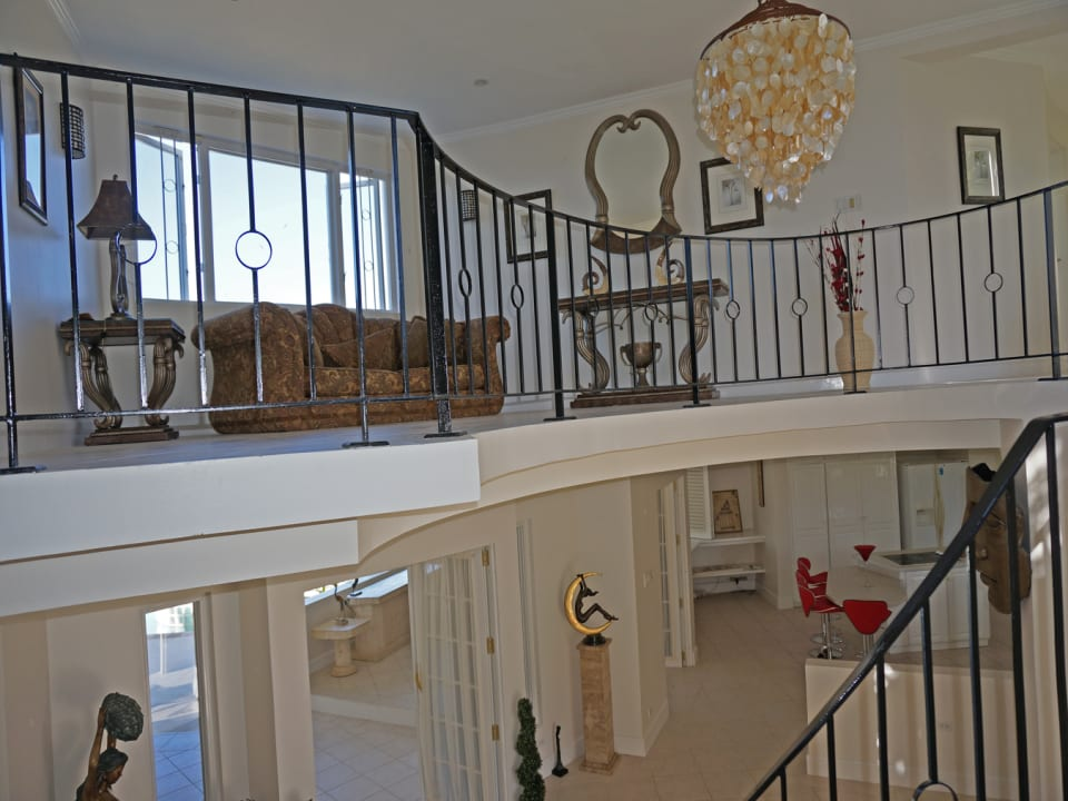 VIEW OF SITTING AREA UPSTAIRS AND STAIRCASE