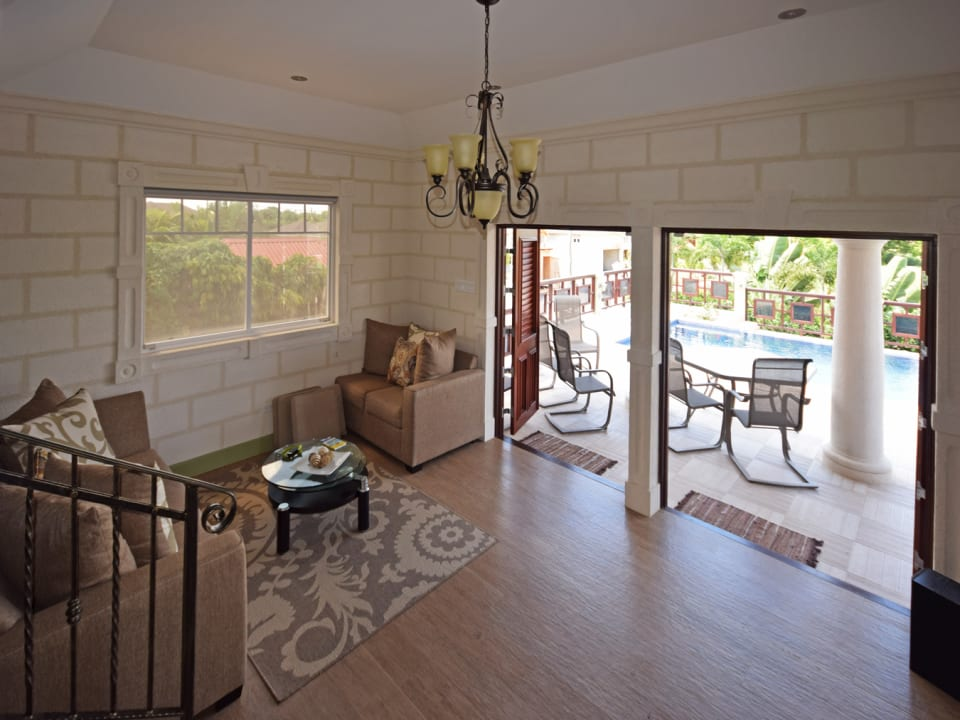 Living room opens onto pool
