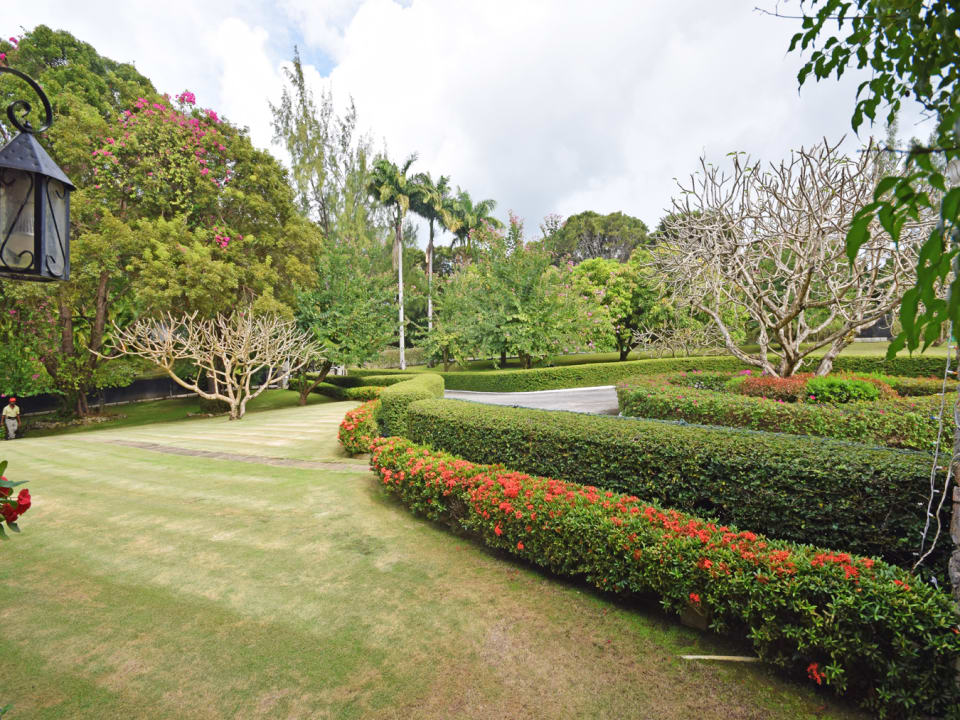 Manicured gardens and driveway