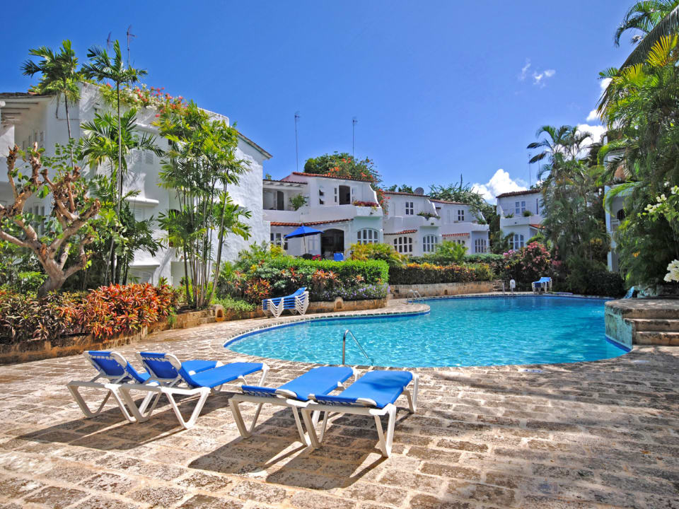 Large pool and coral stone deck shared by 8 villas