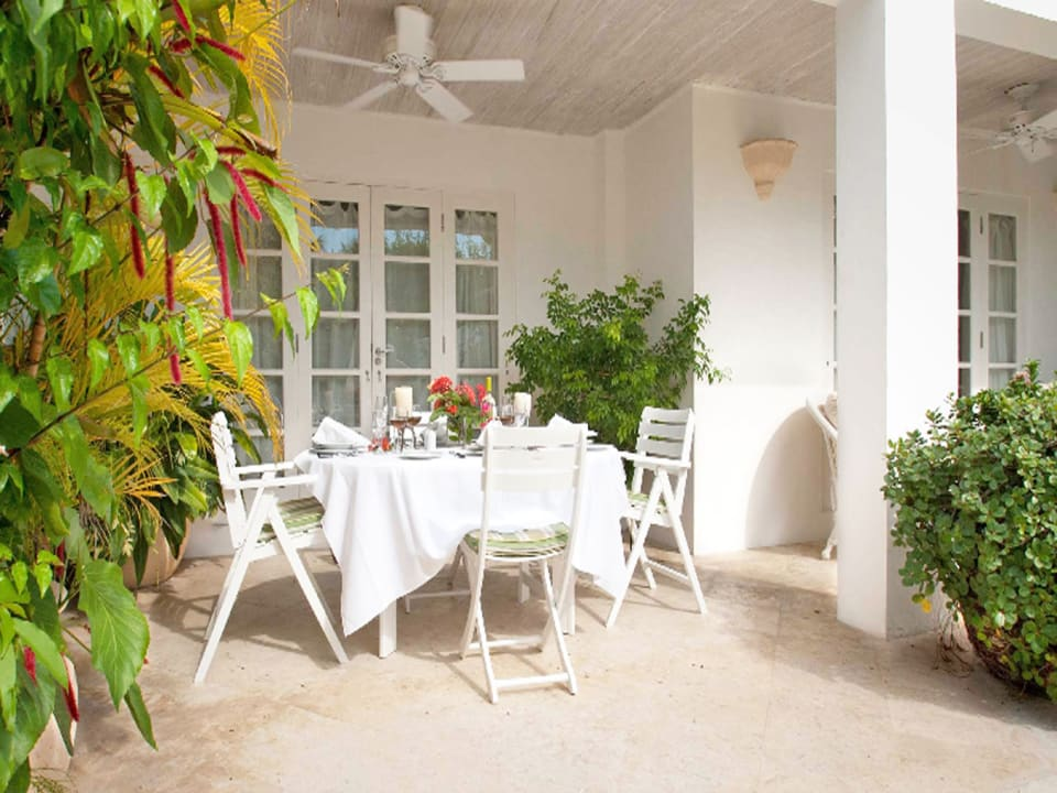 dining terrace adjacent to garden and pool