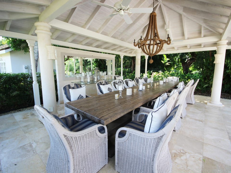 Pool side gazebo with table that seats 16