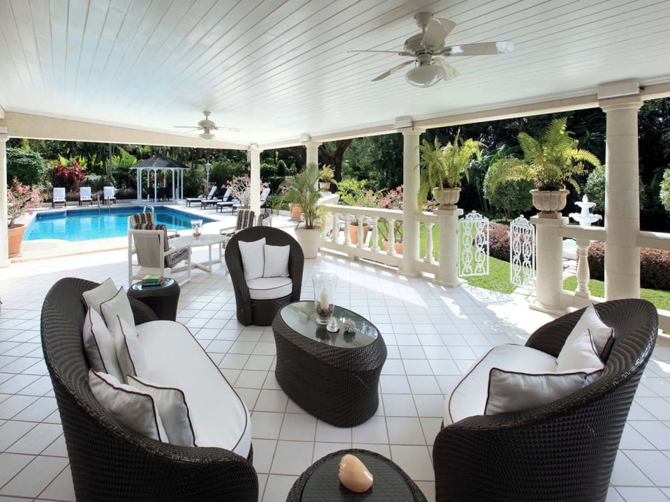 Spacious patio with pool and garden views