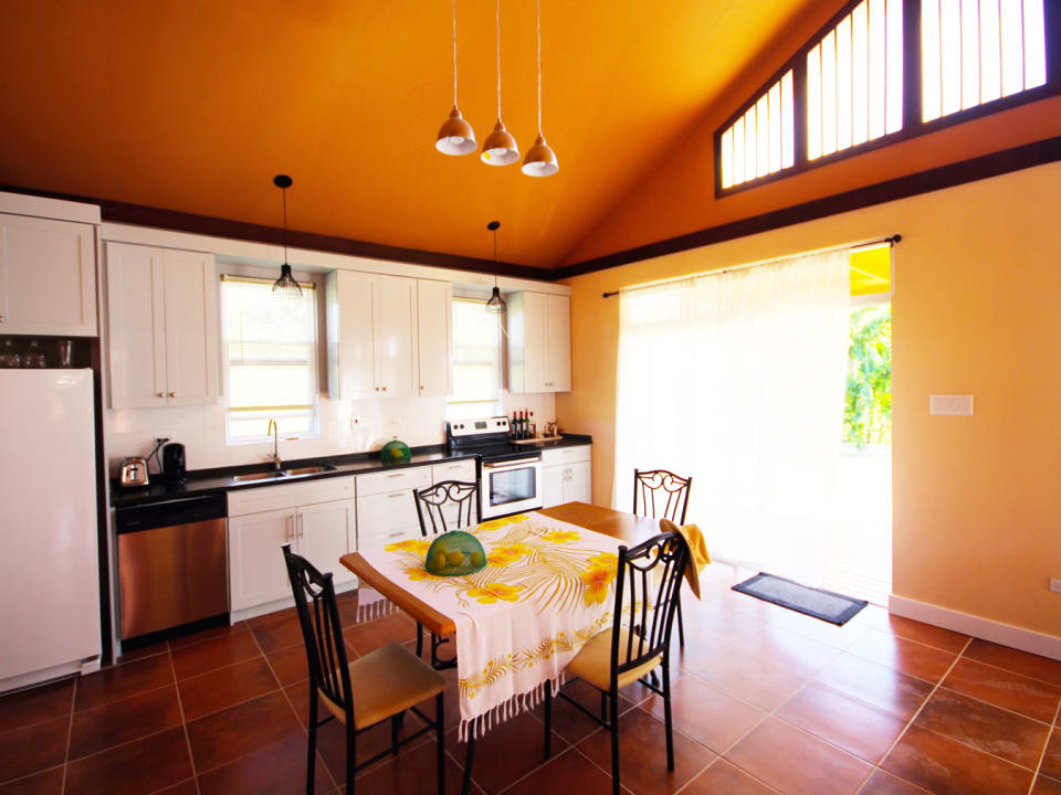 Dining and kitchen that opens onto the patio
