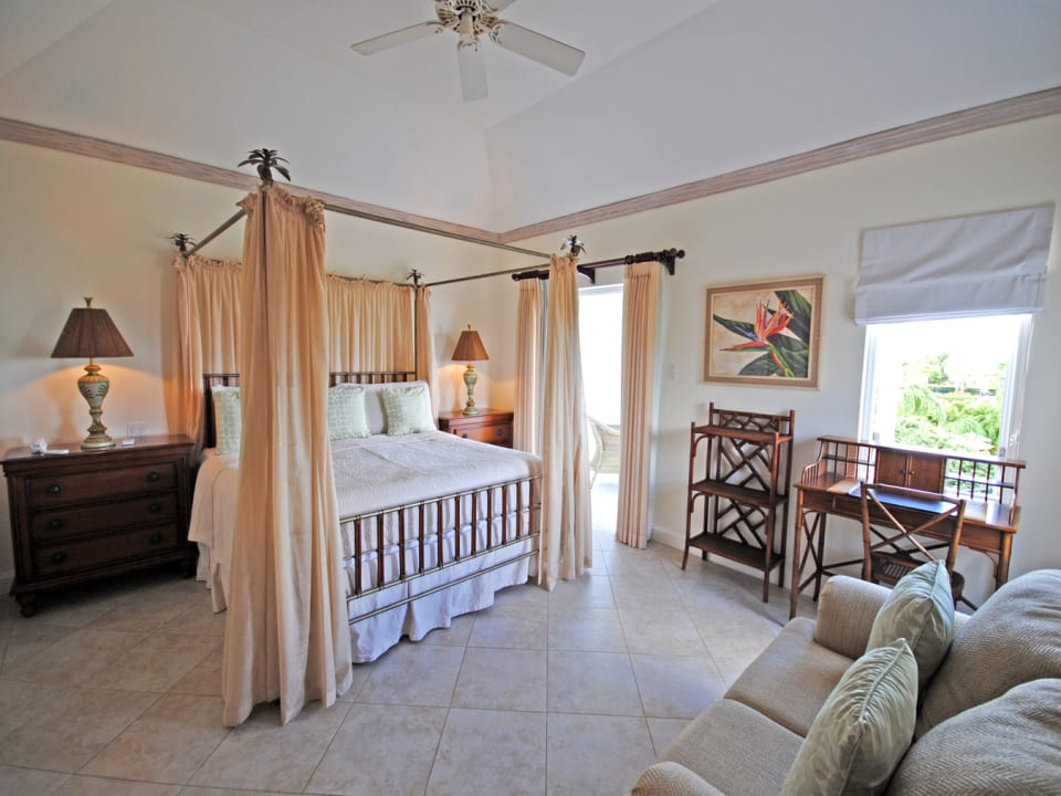 Beautiful master bedroom opens to a balcony on first floor
