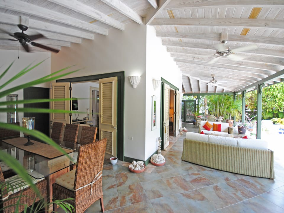 Covered dining terrace leads to pool and sitting room