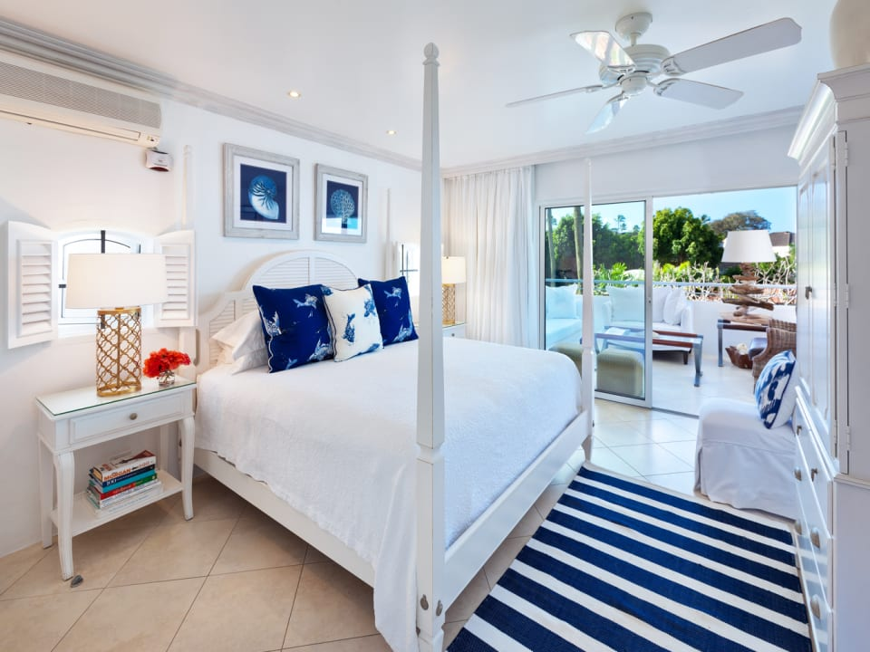 Beautiful master bedroom opens to the verandah with sea views