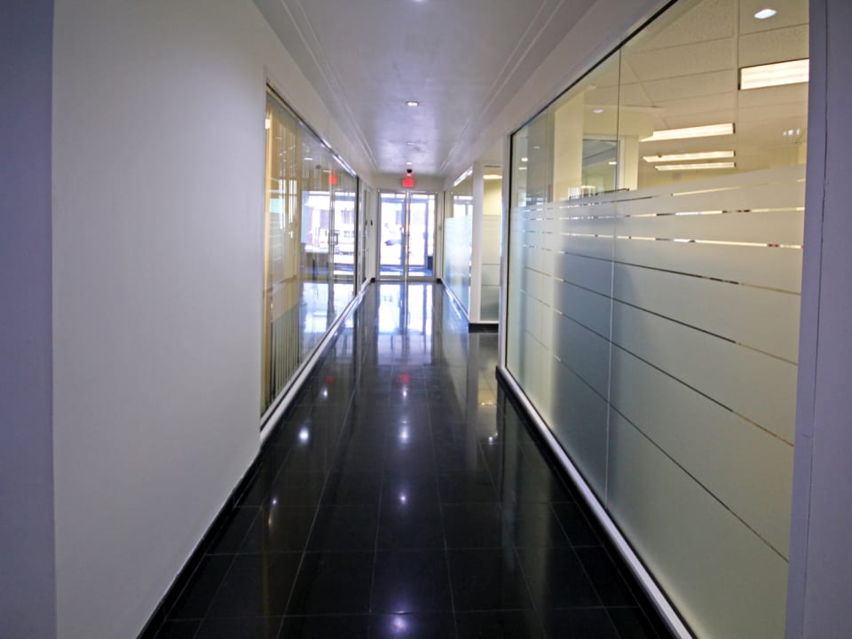 Building corridor with view of exit door