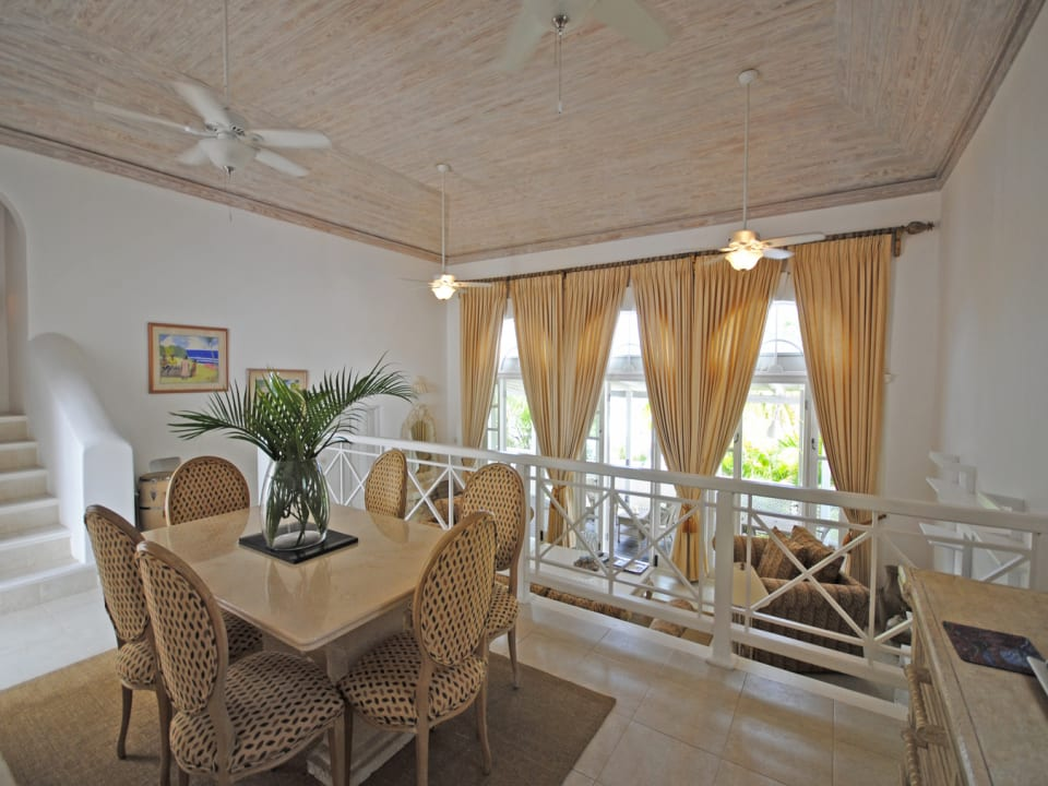 Dining room leads to sunken living room and covered terrace