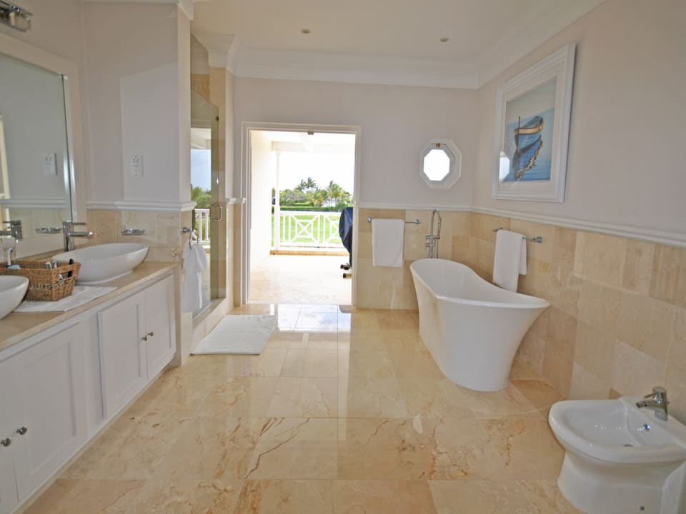 Master bathroom with balcony and sea views