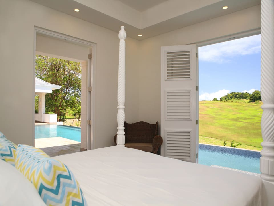 Master bedroom overlooking pool and country