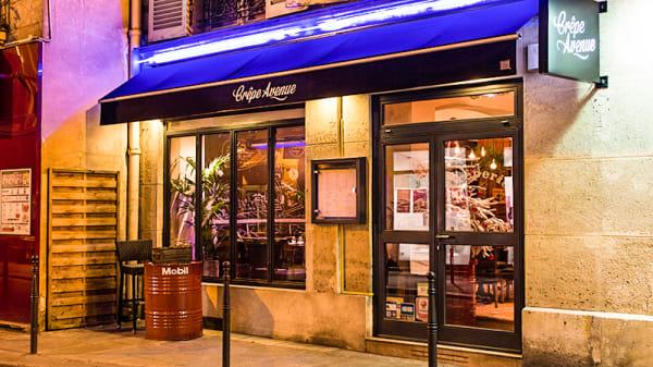 Façade by night - Crêpe Avenue, Paris