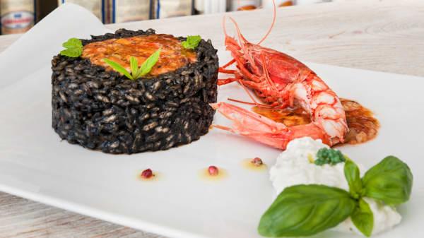 Risotto nero di seppia, ricci e gamberi - Badalamenti Cucina e Bottega, Palermo