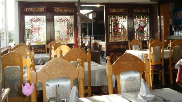 Vista de la sala - Restaurante New World, Tías