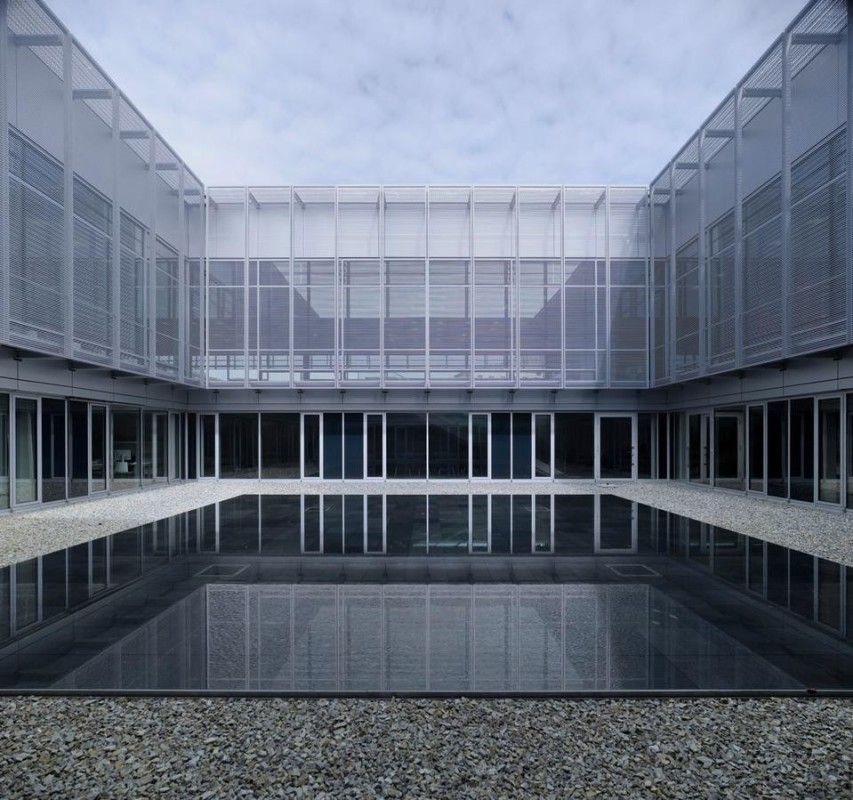 Inside, few divisions and a small inner courtyard with a little black water basin. Nothing elevates the building from being just a simple enclosure for its contents.