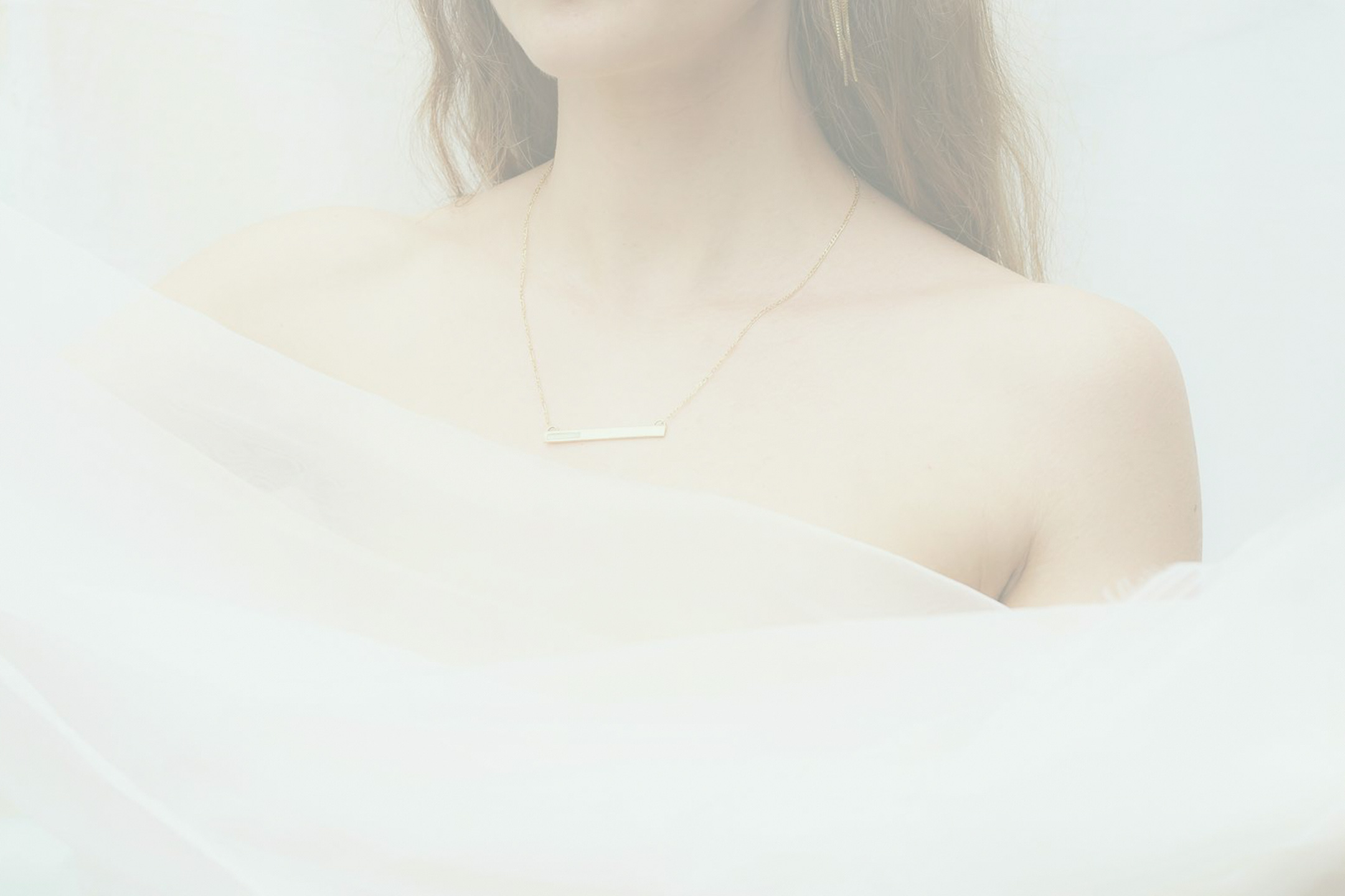 Beautiful chain dangling from a woman's neck