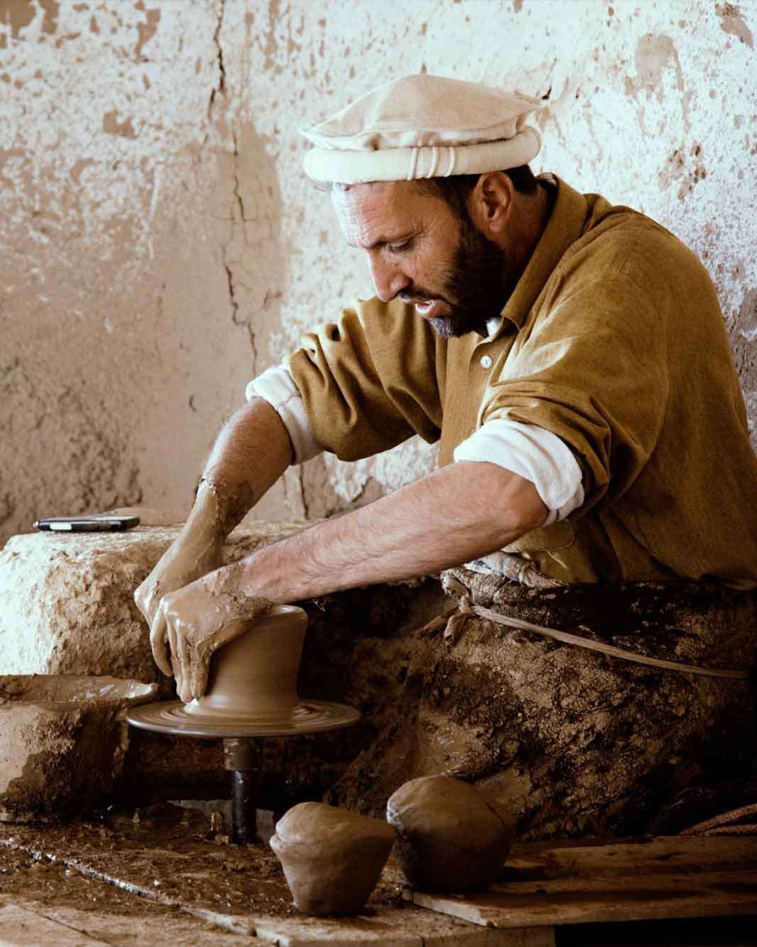 A craftsman focused on his pottery work
