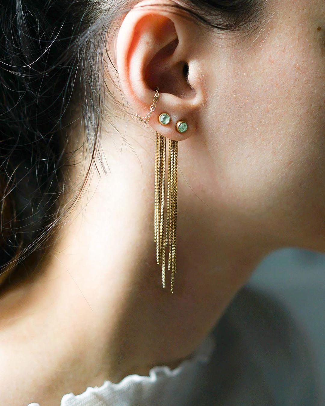 Golden earrings with a blue gem