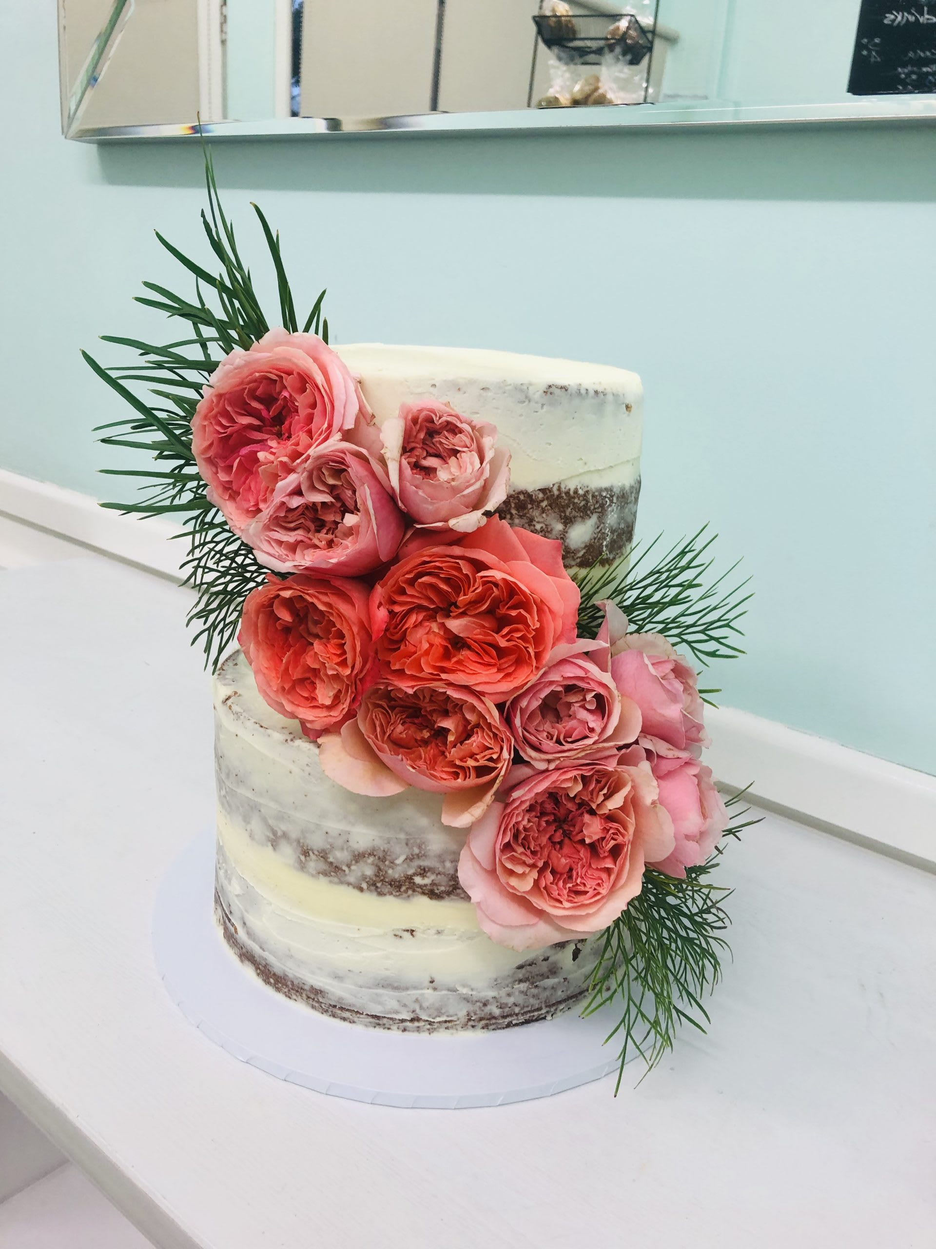Naked cake with cascading flowers