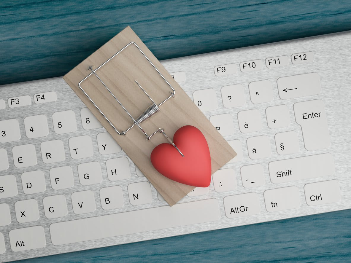 a mousetrap with a heart on a keyboard
