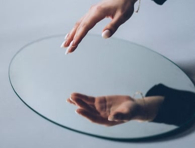 A hand reflected in a mirror