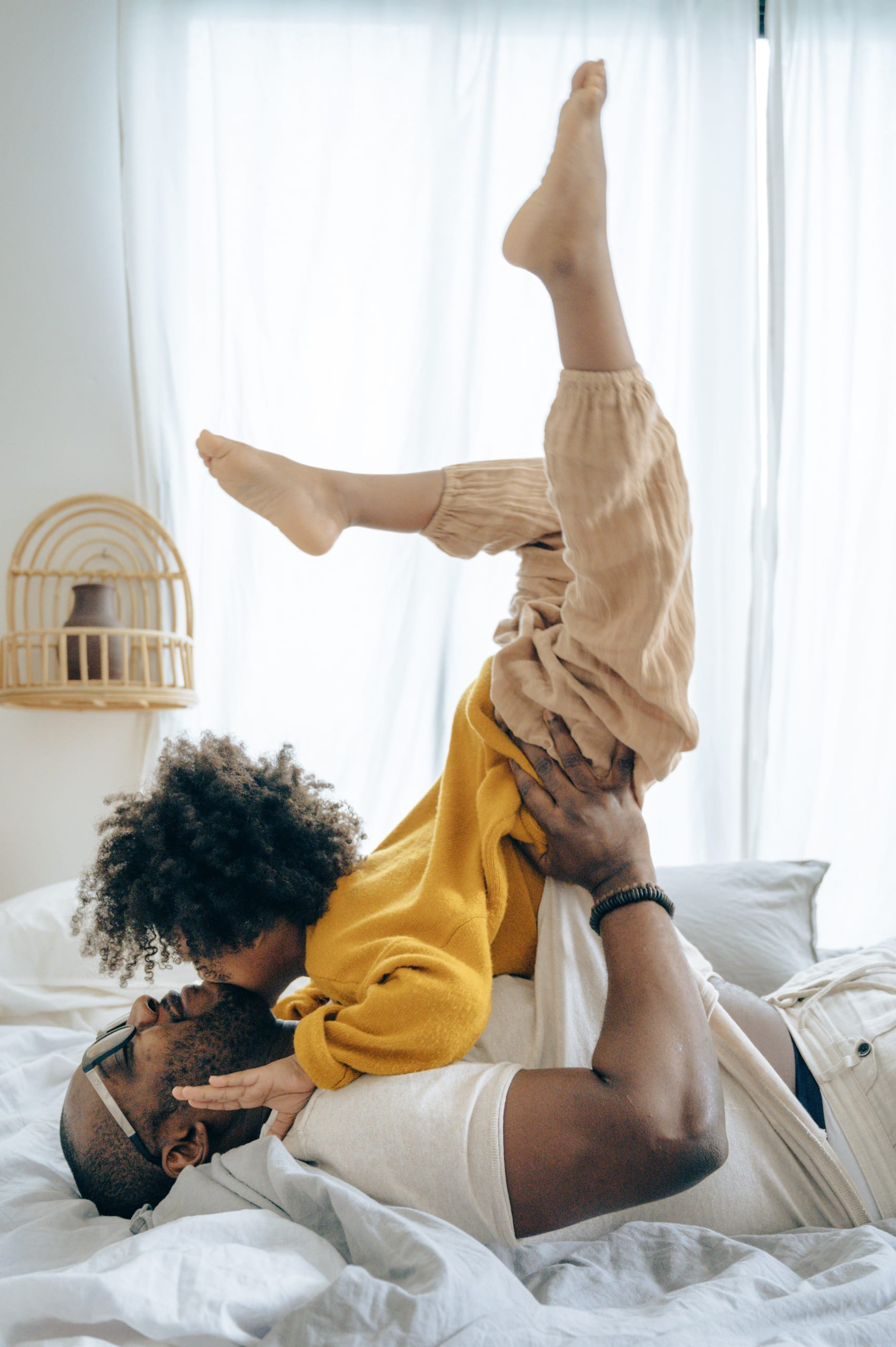 happy dad lifting kid in the air
