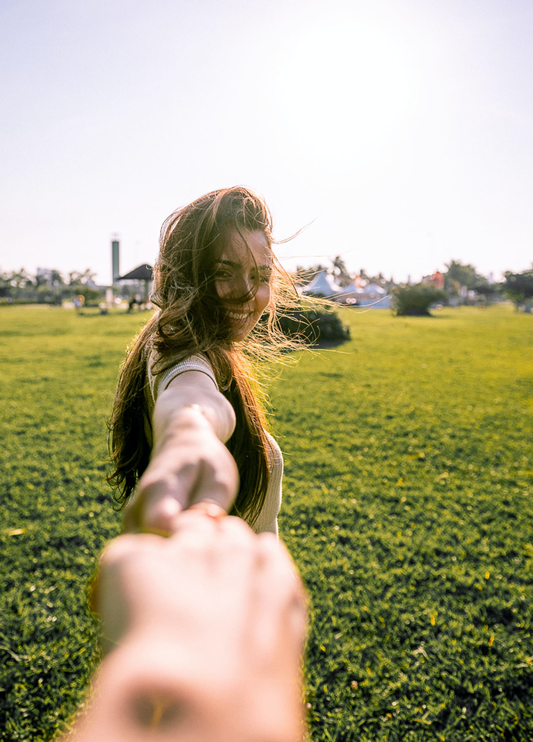 woman holding hands leading