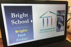 Screen shows Bright Fest Friday image and meeting leaders