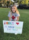 Student puts signs in the yards of her teachers....