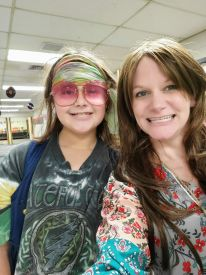 Mrs. Jessup and 5th grader, Jayden Williams are groovin their way through the 70's!