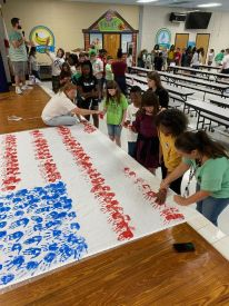 3rd-5th grade students creating a remembrance flag