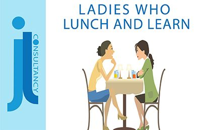 Ladies who lunch. This image contains a picture of two ladies sat around a round table eating lunch and talking