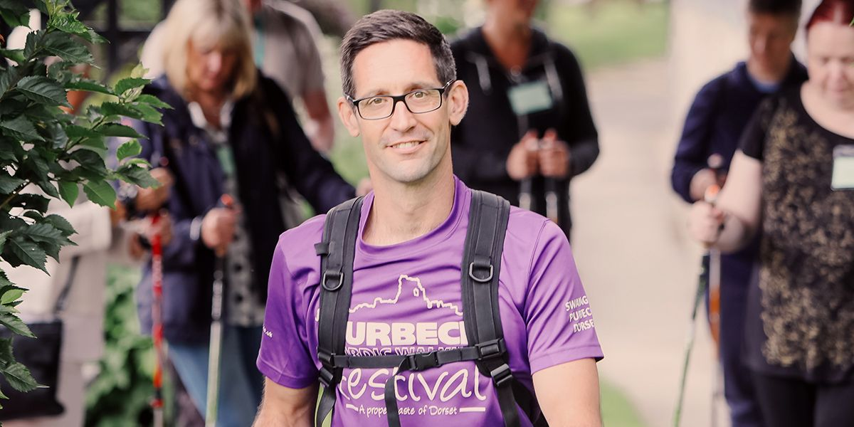 This is a picture of Matt Gibbs. Matt is a tall thin white man who wears glasses and a purple tshirt