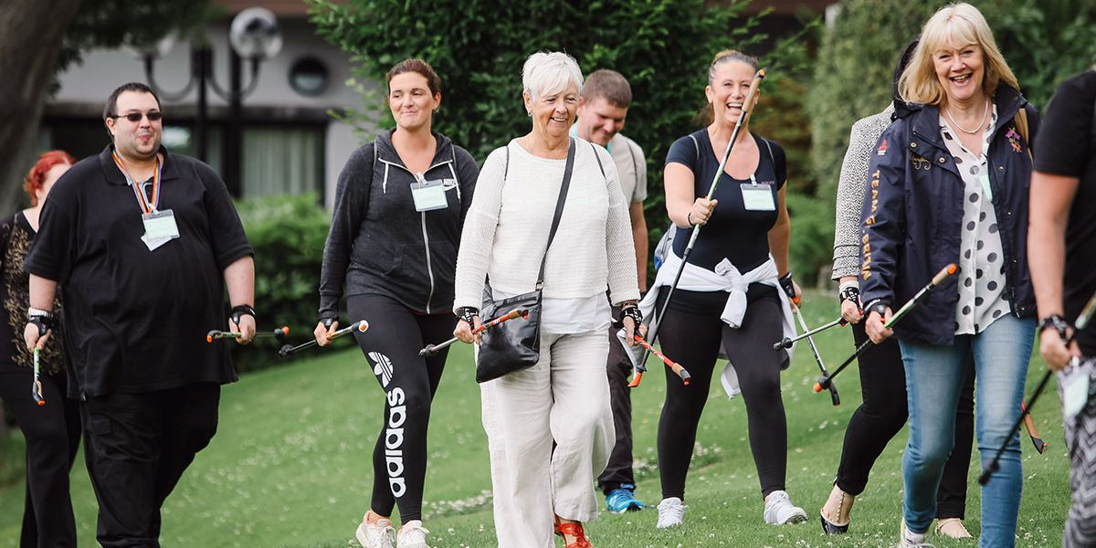 This is a picture of a group of office workers on an experience and team building day. They are using Nordic Walking Poles