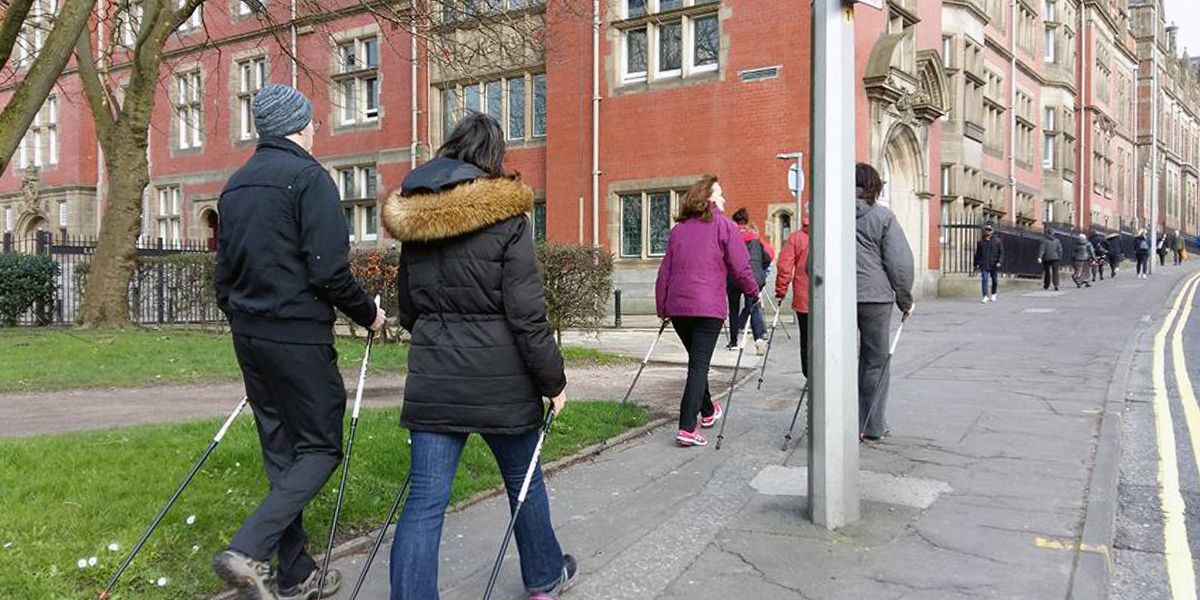 This is a picture of a group of office workers going for a walk around the UCLan buildings in Preston. They are using Nordic Walking Poles