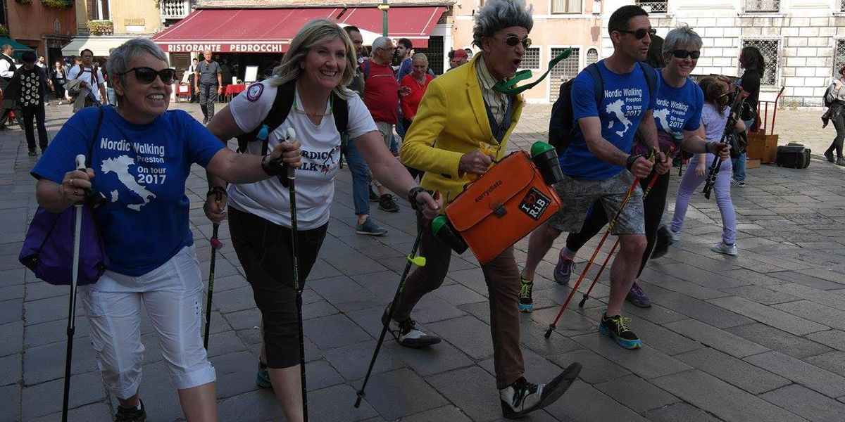 This is a picture of a group of Nordic Walkers on a charity event in Italy. One of the walkers in the middle is in Fancy Dress. Matt Gibbs is walking next to him