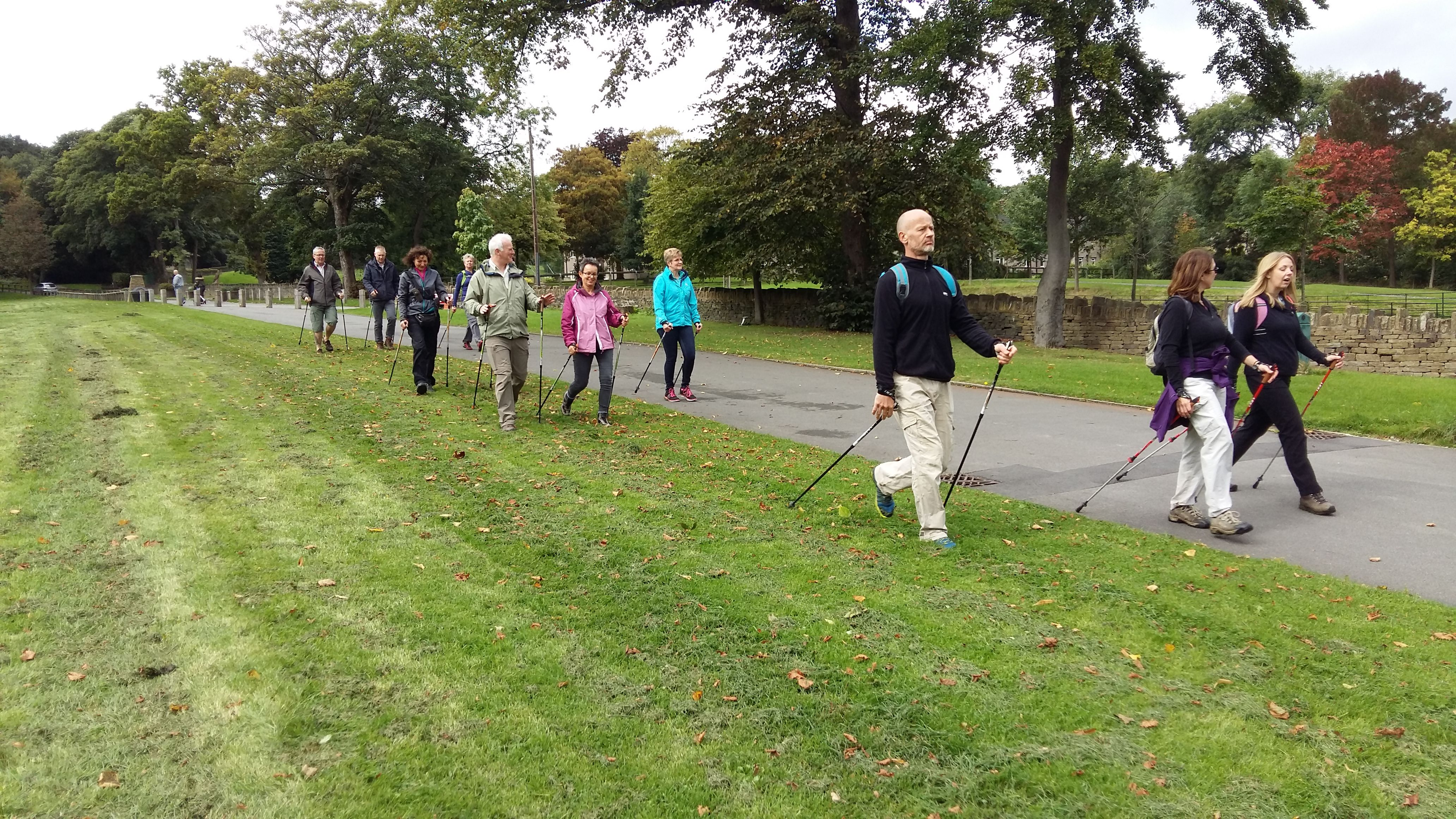 The image shows a group of Nordic Walkers in the grounds of Shibden Hall