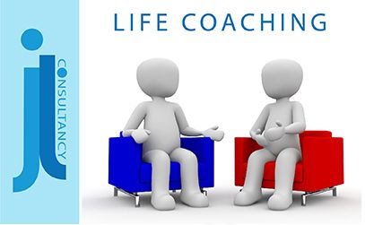 Life Coaching. This image is of two people sitting talking. One in a red chair and one in a blue chair. The people are faceless, genderless and colourless.