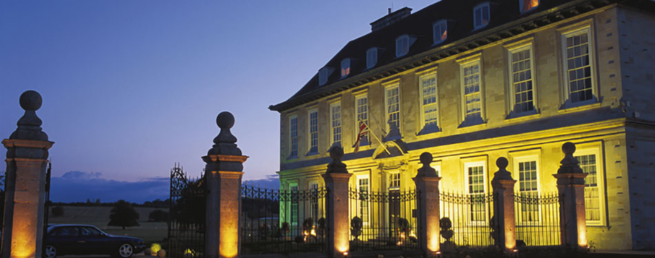 Stapleford Park Country House Hotel lit up at night