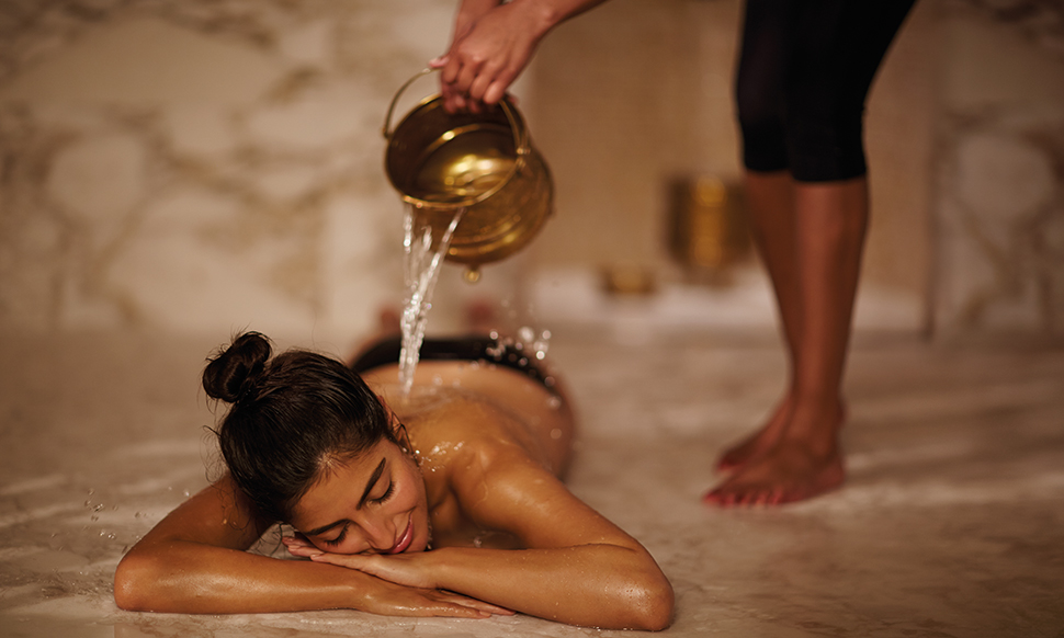woman at spa hammam enjoying relaxing spa therapy massage in morocco