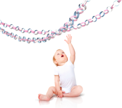 Baby reaching for birthday decorations