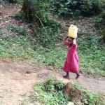 The Water Project: Shitaho Community, Andrea Kong'o Spring -  Carrying Water On Head