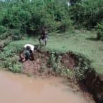 The Water Project: Eluhobe Community, Amadi Spring -  Children Get Local Materials Covered By The Flooding Waters
