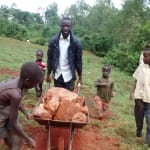 The Water Project: Eluhobe Community, Amadi Spring -  Wewasafo Staff Leading The Children In Transporting Hardcore